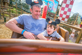 Disney World with father and son riding a ride.