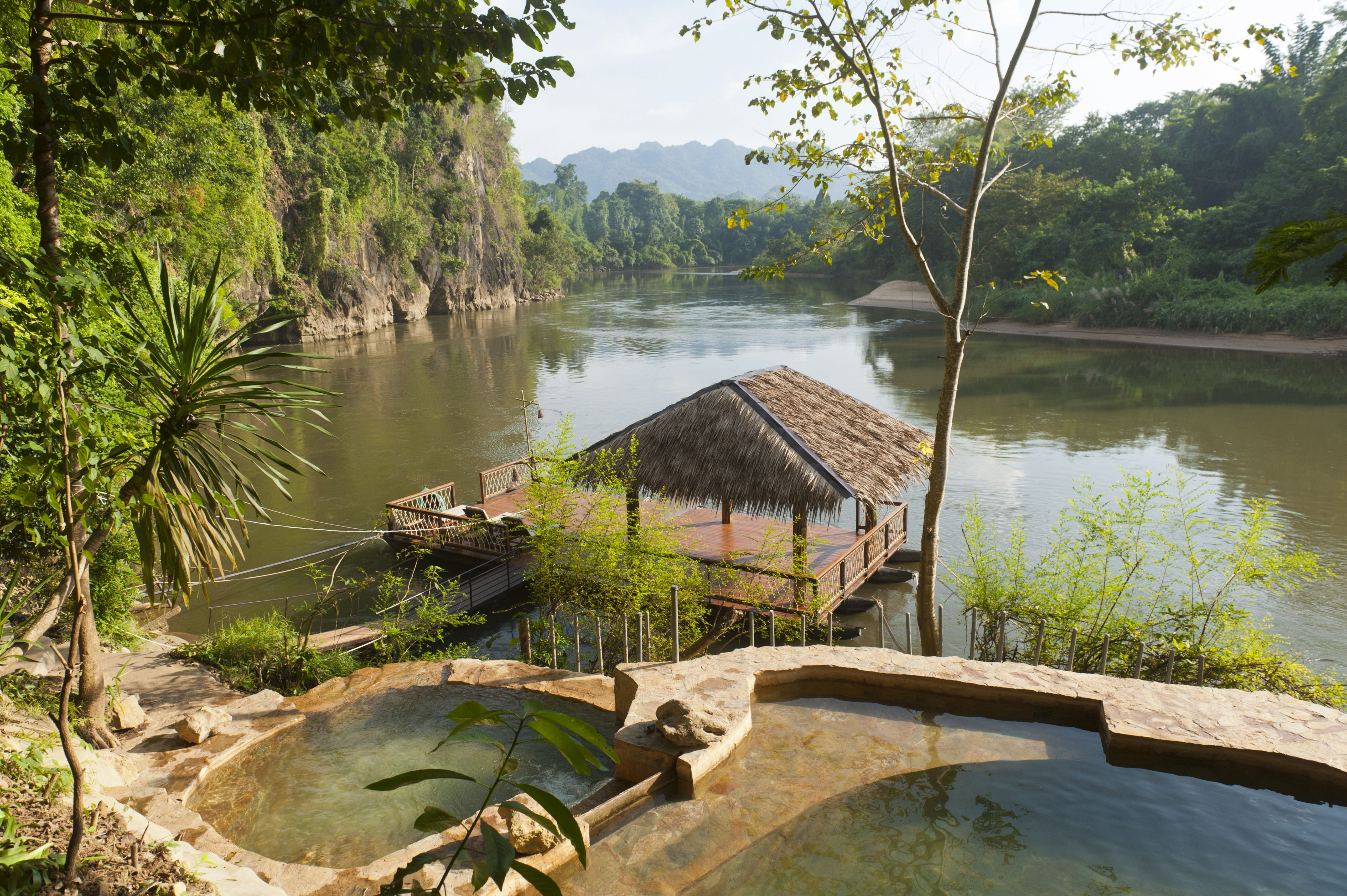 A floating hut and pool by the river in Kanchanaburi, Thailand
