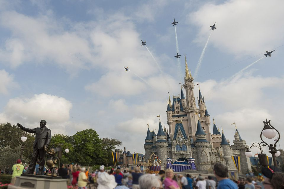 U.S. Navy Blue Angels Soar Above Cinderella Castle At Walt Disney World Resort
