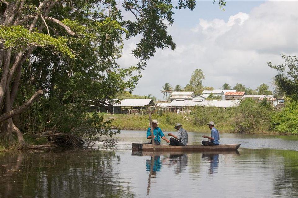 Mennonites on a river.