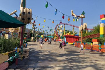 Toystory land in walt disney world with few guests walking around