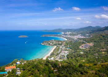 Beautiful turquoise ocean wave with boats and sandy coastline from high view point Kata and Karon beaches, Phuket, Thailand