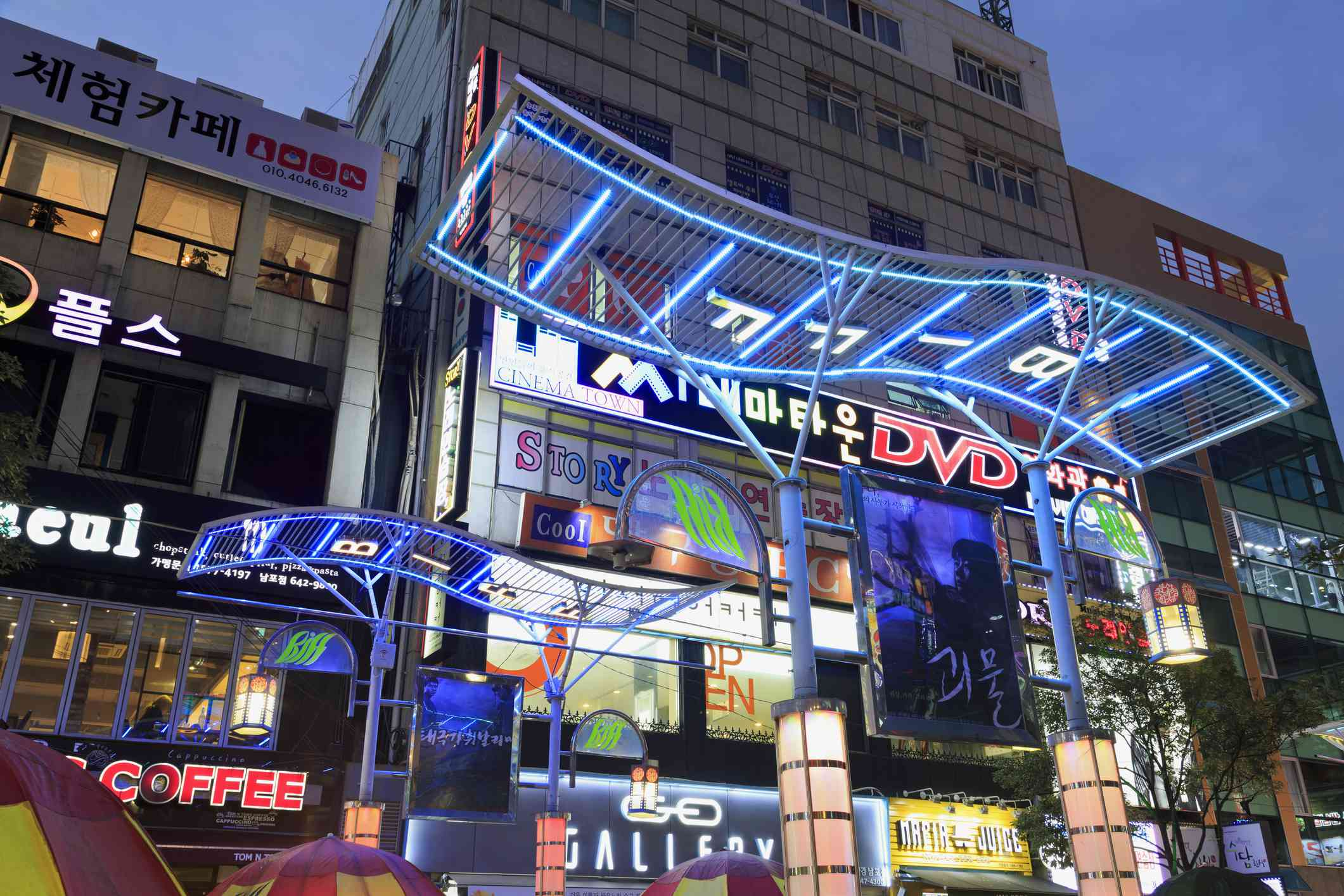 shops and neon signs at night in Busan, South Korea