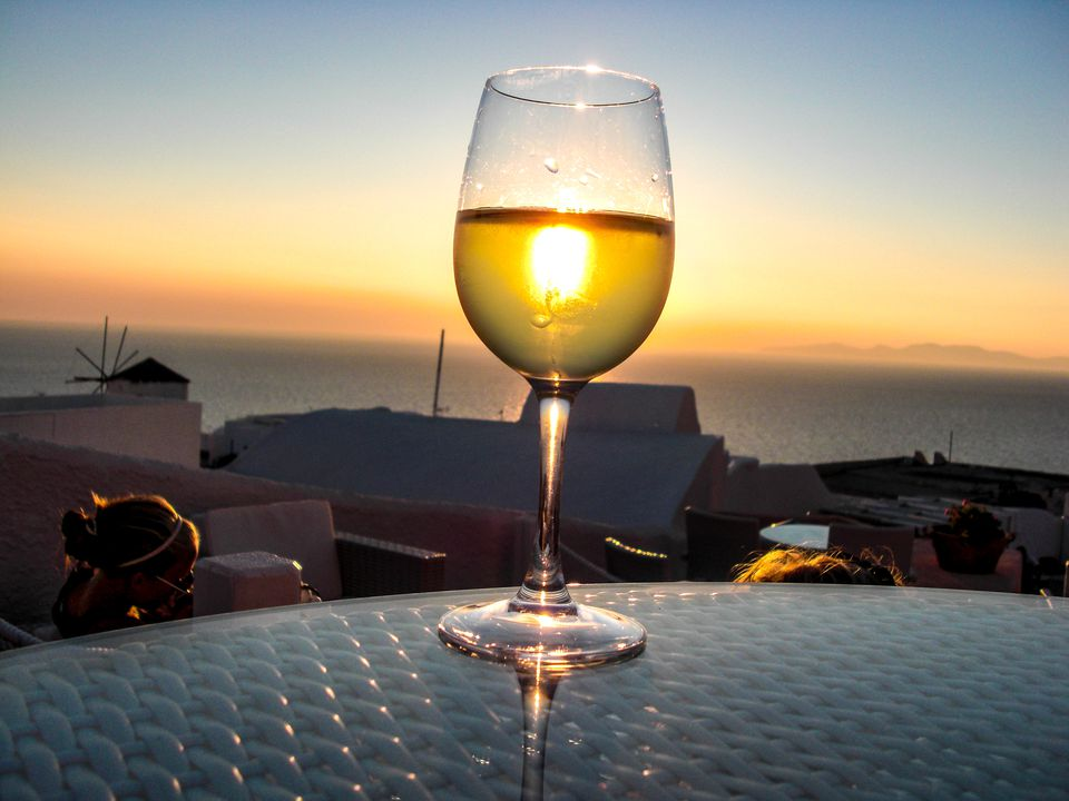 Retsina Served On Table In Restaurant By Sea At Santorini