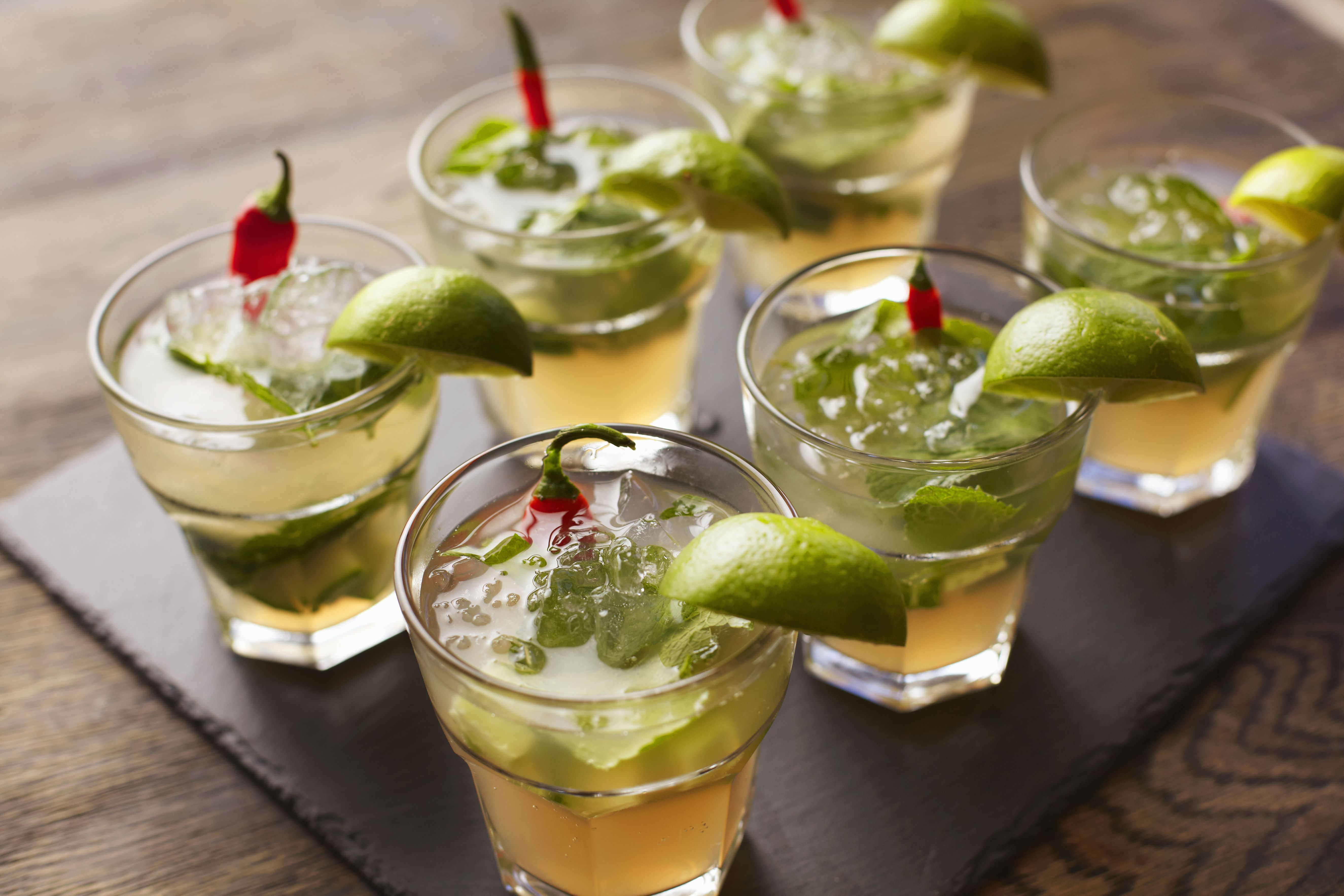 Chilli vodka cocktail garnished with lime wedges