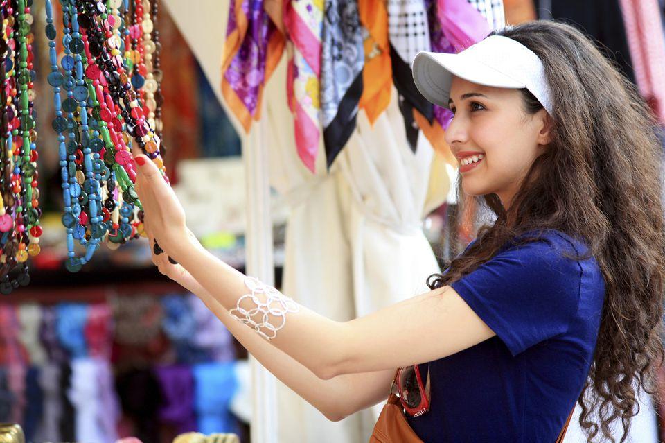 Tourist shopping in 'El Rastro' Flea Market,Madrid