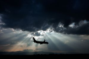 Airplane and stormy clouds