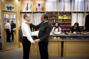 A man getting fitted by a Hong Kong Tailor