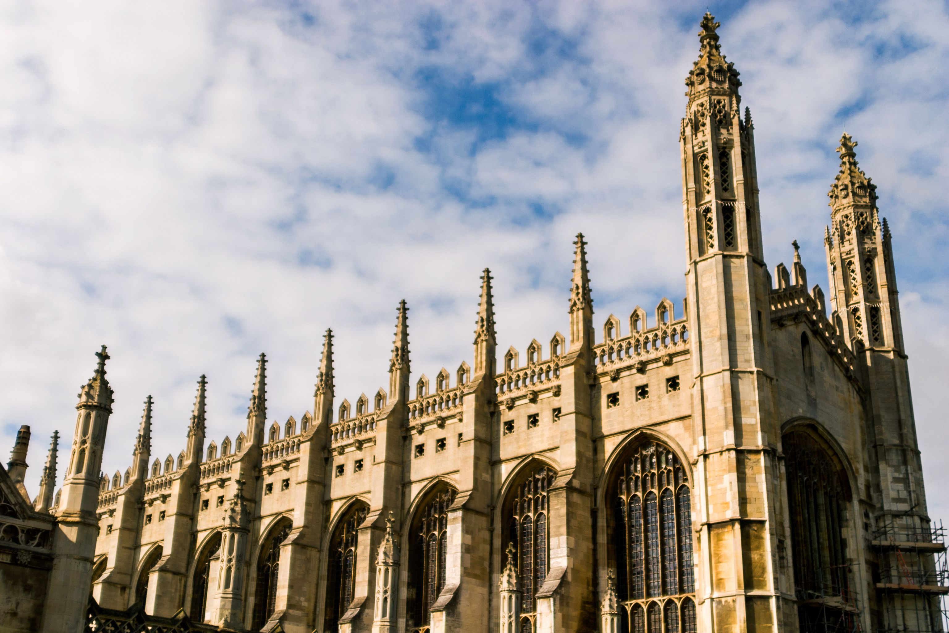 Dramatic wide angle of the outside of Kings College building in Cambridge