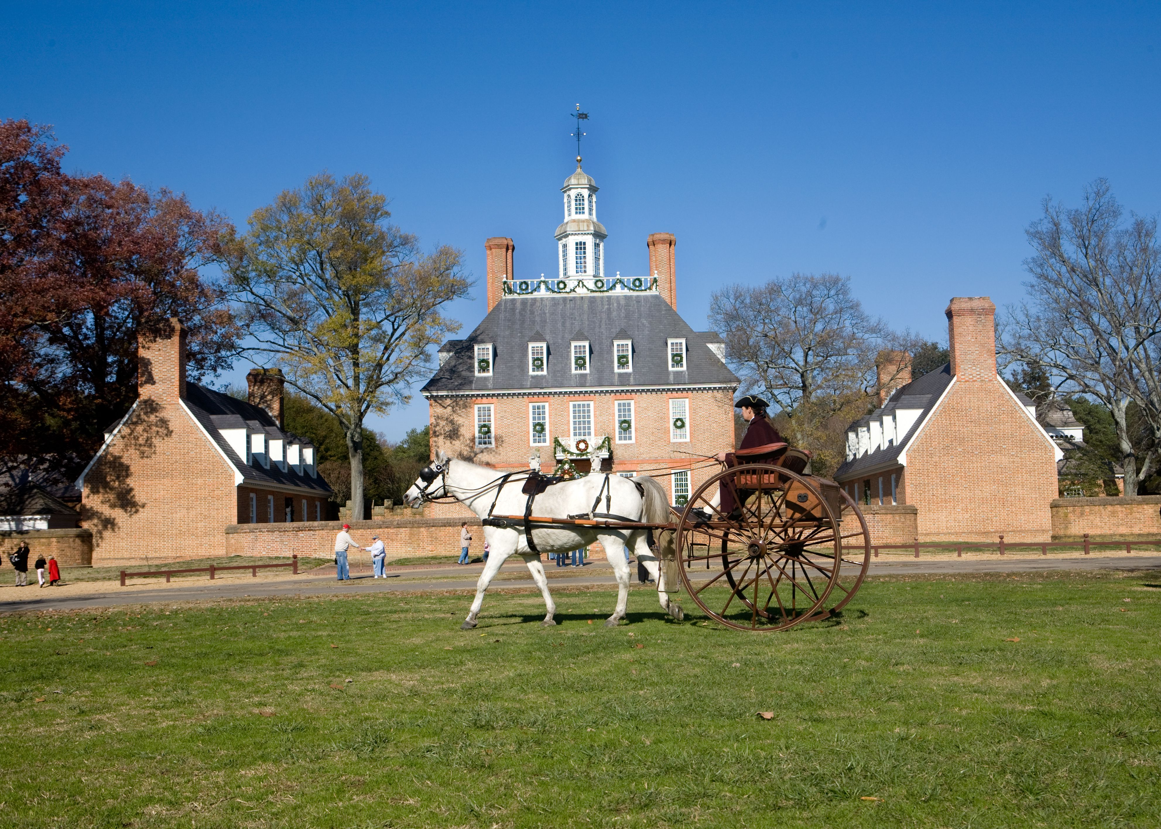Colonial era horse drawn carriage in front of the Governor's Palace