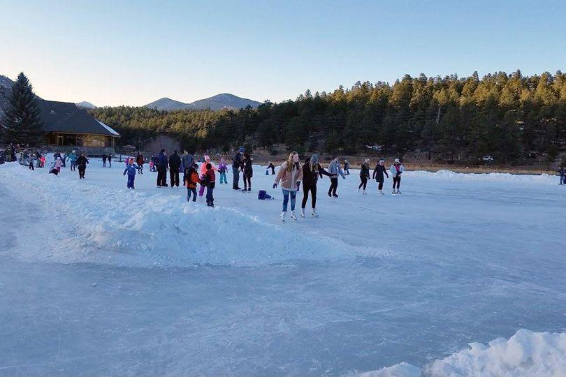 Evergreen Lake with people enjoying iceskating