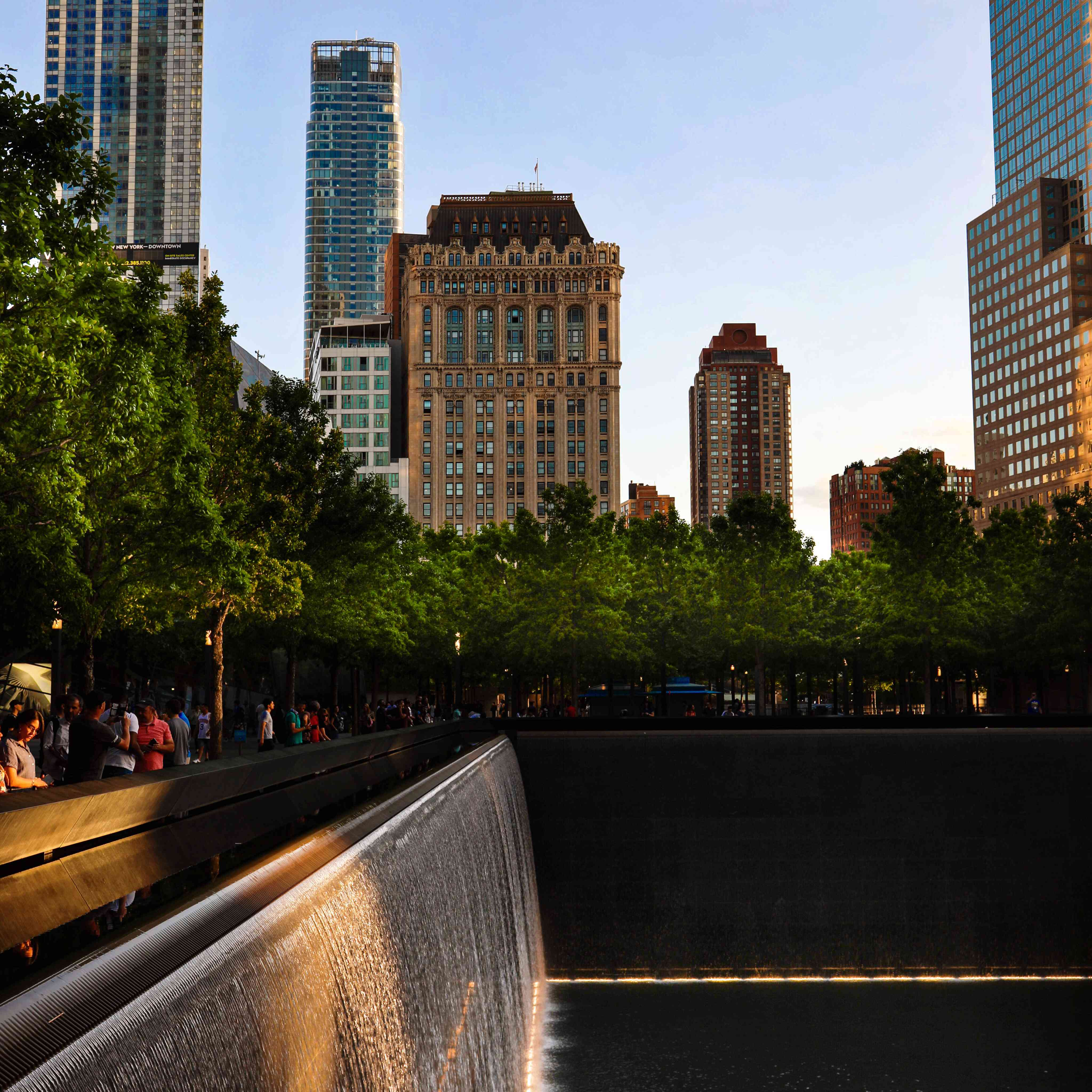 A view of the 9-11 waterfall with buildings in the background