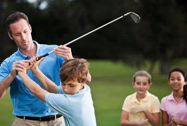man teaching boy how to golf at La Cantera Hill Country Resort: San Antonio, TX