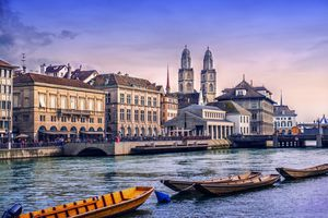 Grossmunster Cathedral with River Limmat in Zurich at Sunset