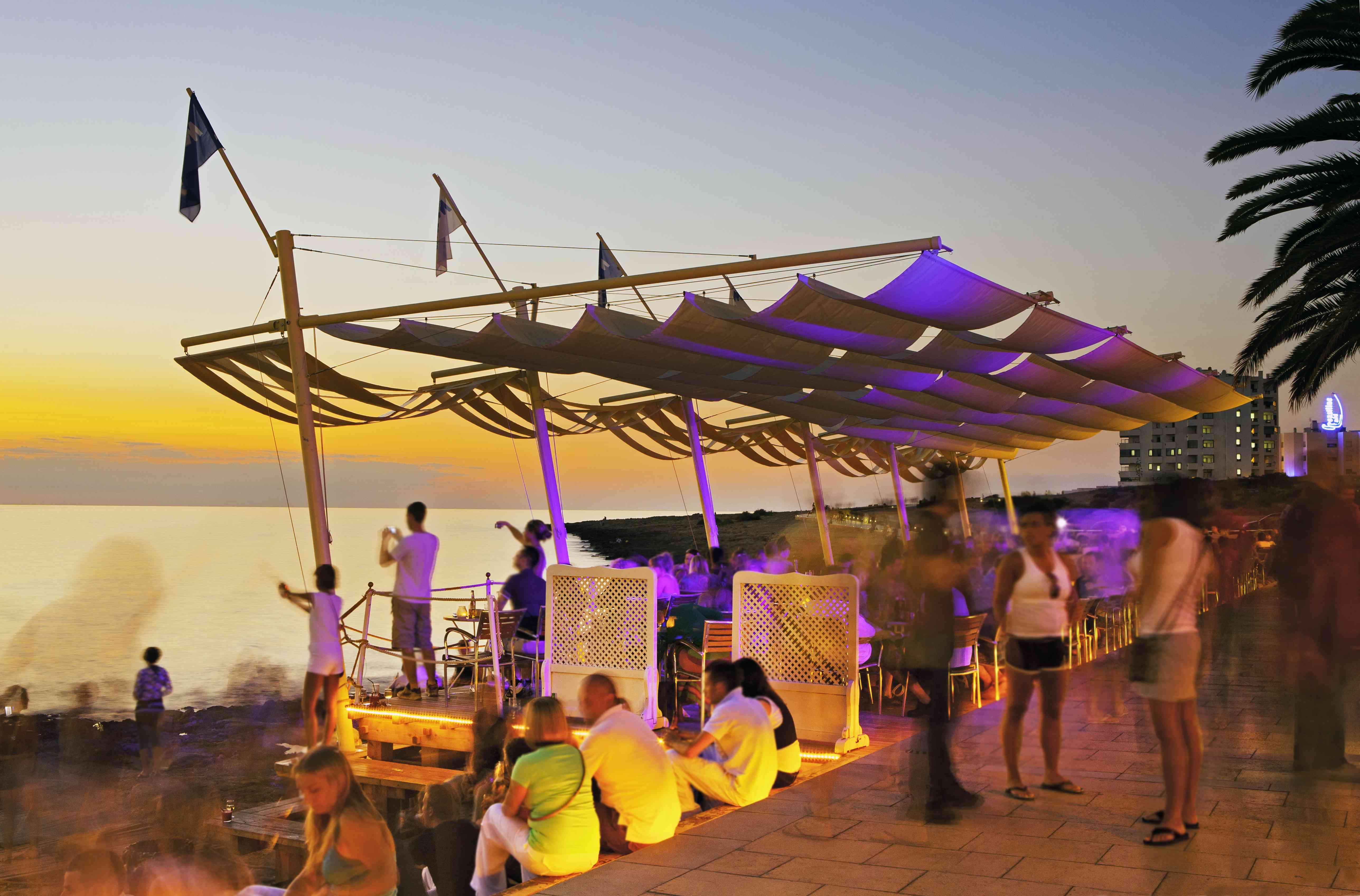 People watching sunset. Café del Mar, San Antonio