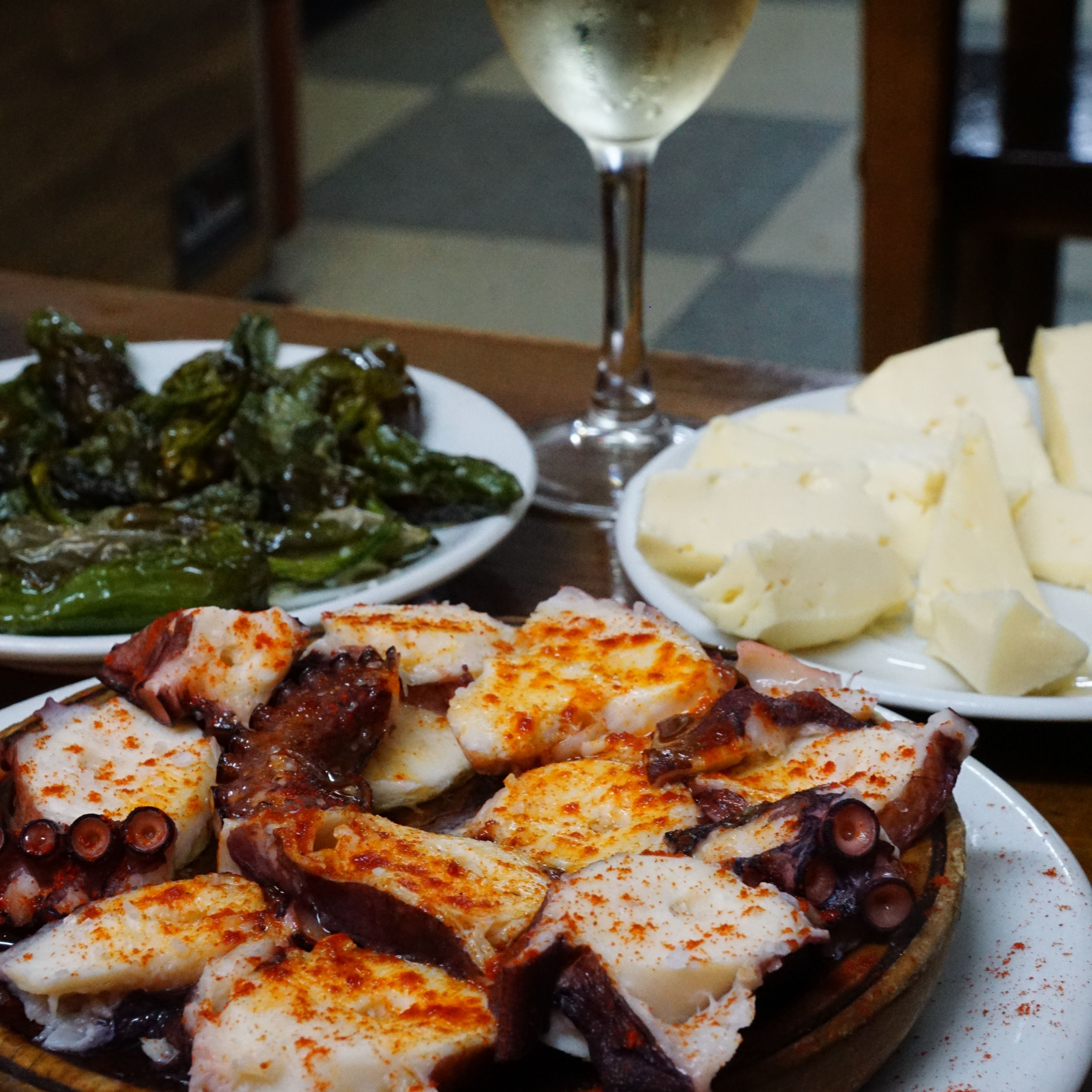Galician style octopus (pulpo a la gallega), tetilla cheese and padron peppers