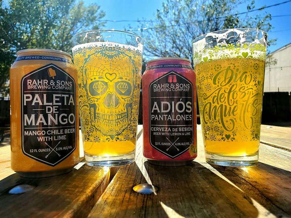 Two beer can and two full glasses of beer from Rahr & Sons Brewing Company