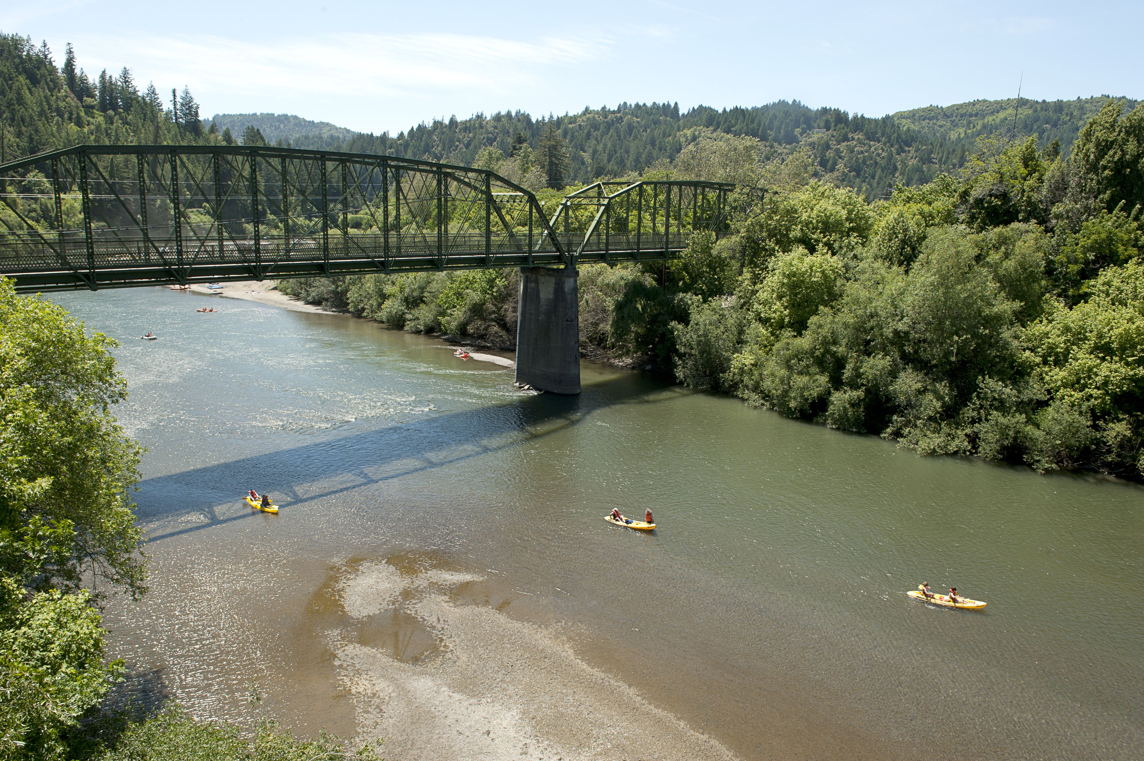 Usa California People Canoeing On Russian River Near Guerneville Bridge