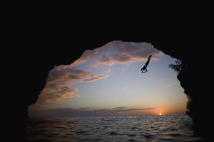 Young Man Diving into Sea at Pirate's Cave