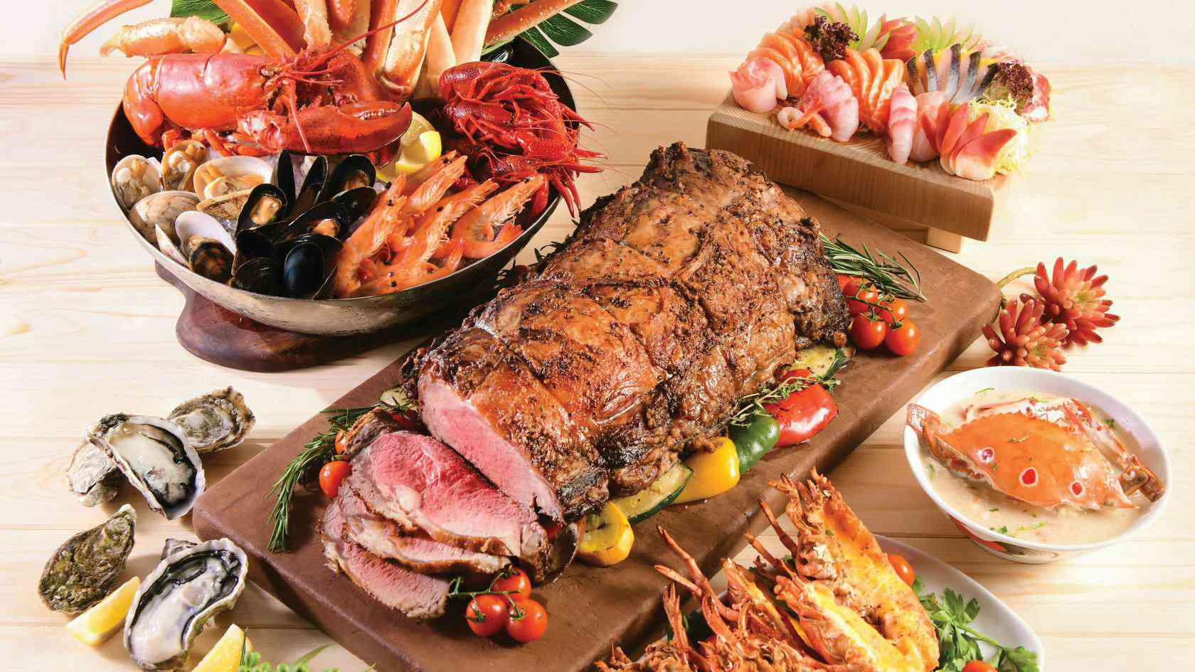Display of roast meat, a bowl of shellfish, sushi, halved oysters and more.