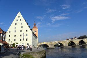 River ships dock near the ancient bridge near old town Regensburg