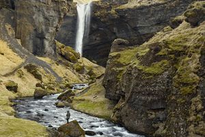 Standing In The Canyon Of Kvernufoss Waterfall, Iceland