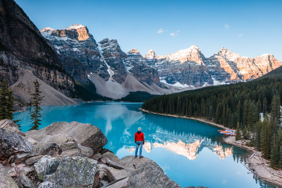 Man at Moraine lake at sunrise, Banff, Canada