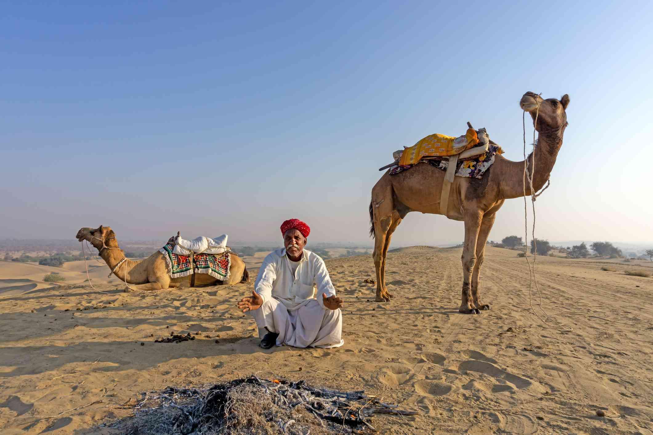 An Indian Man with Camel at Thar Desert