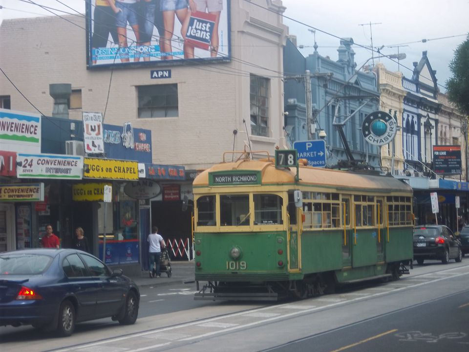 A picture of a classic Melbourne tram and cars