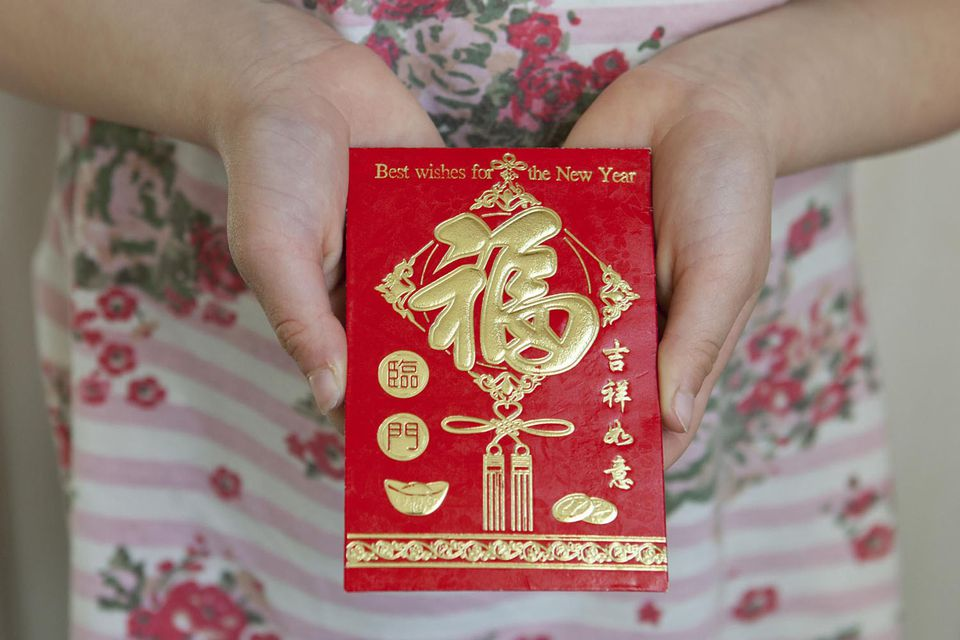 Woman holding a Honbao Red Envelope
