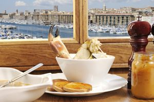 Bouillabaisse soup with view over the port in Marseille, France