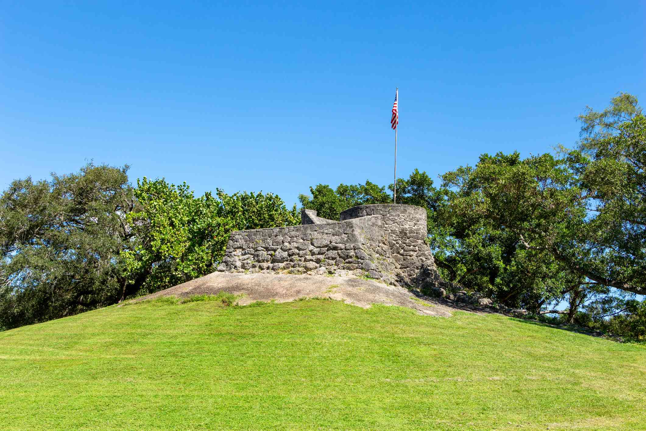 An observation mound with a stone structure at Greynolds park in Miami