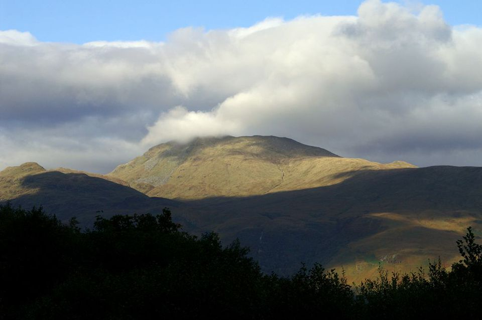 Ben Lomond, at 3,196ft, is one of Scotland's Munros - mountains of at least 3,000 feet. Just north of the mountain, Loch Lomond narrows like a fjord.
