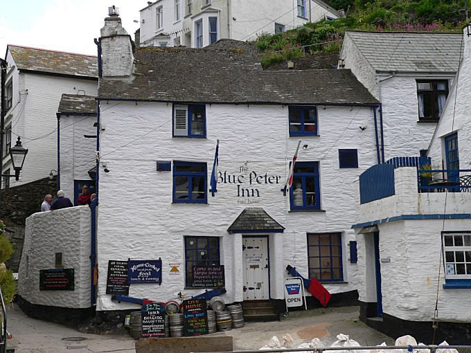 White washed building of The Blue Peter Inn with blue windows