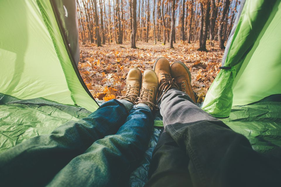 POV of couple lying in tent and enjoy first day of camping in beautiful nature