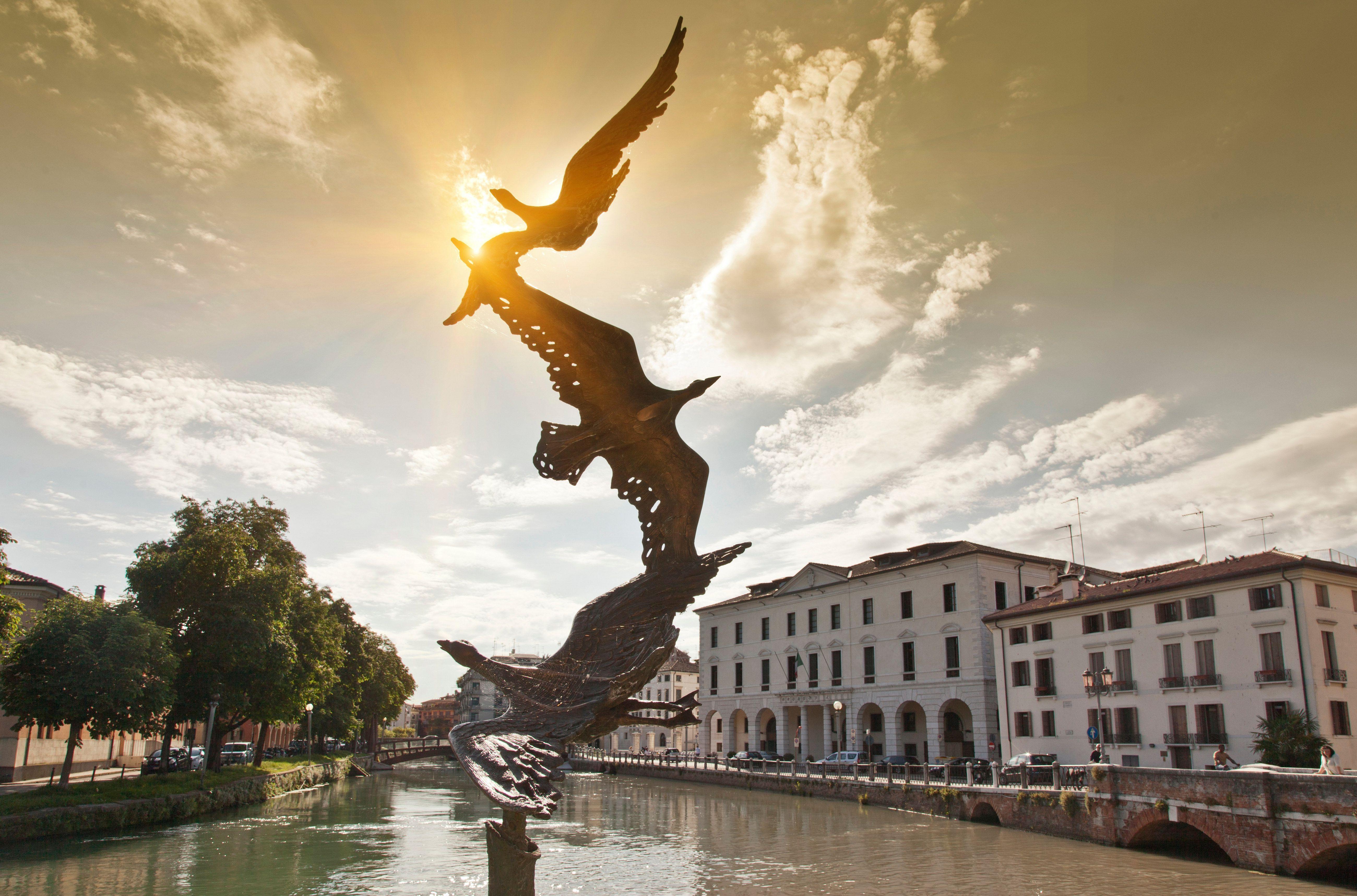 Bird sculpture on river, Treviso, Italy