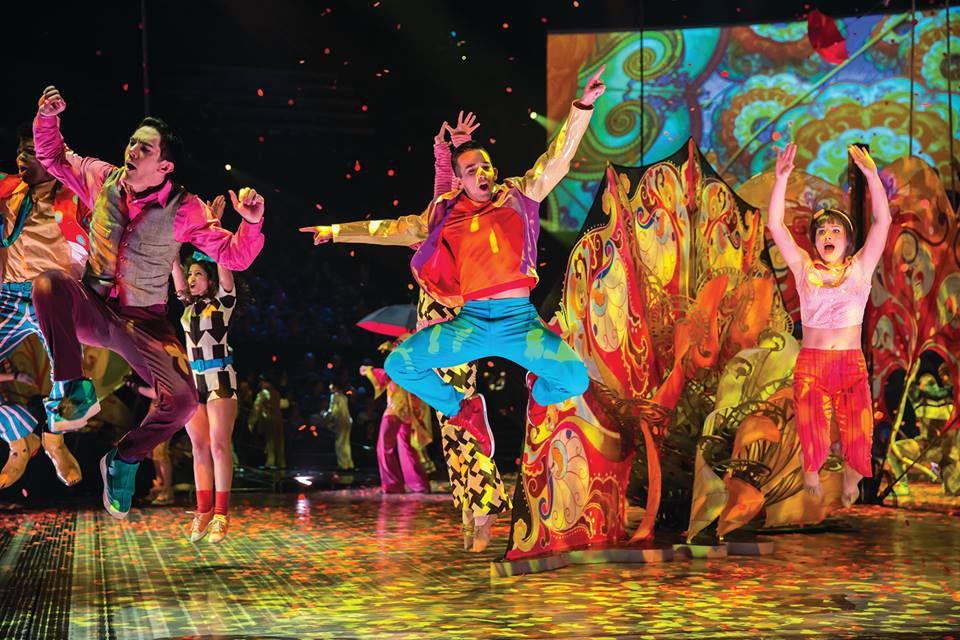 Dancers jumping at the Cirque du Soleil show