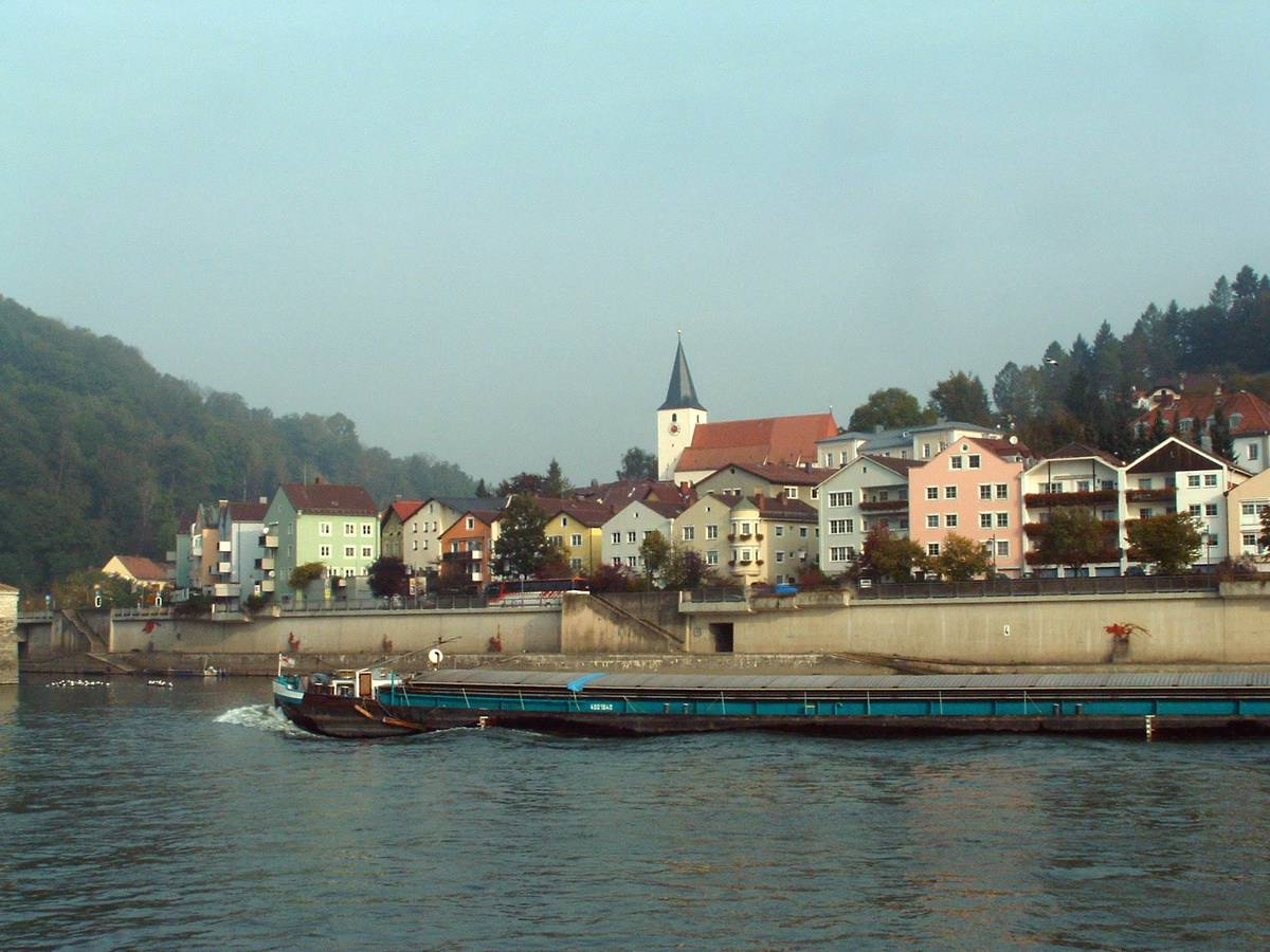 A barge on one of the three rivers that cross through Passau, Germany