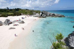 People enjoying Horseshoe Bay Beach in Bermuda.