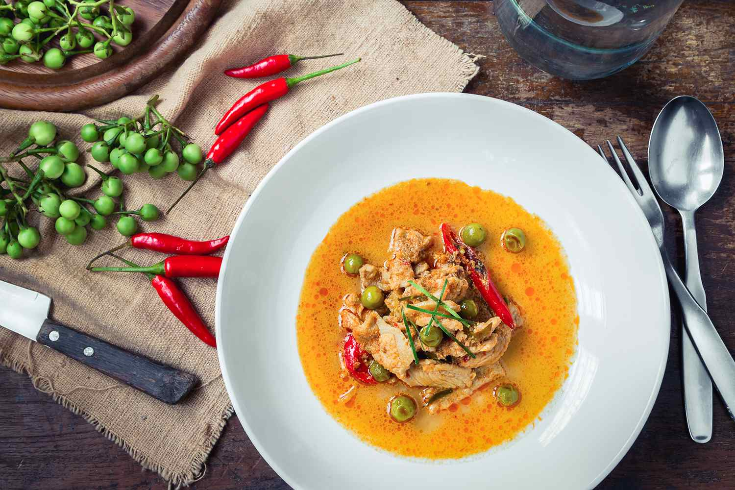 Panang Curry with Pork on wooden table.