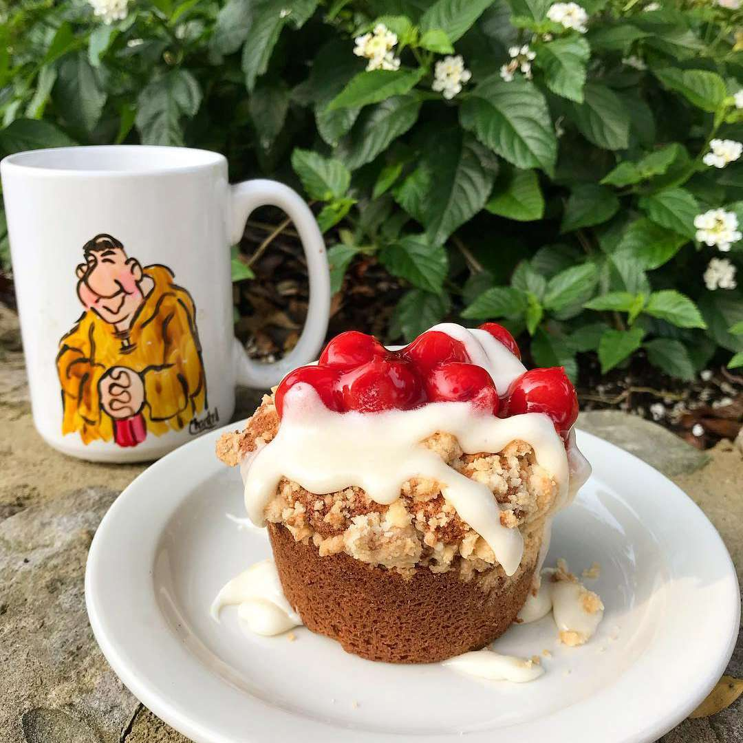 A cup of coffee and a cherry pie muffin from Brother Juniper's