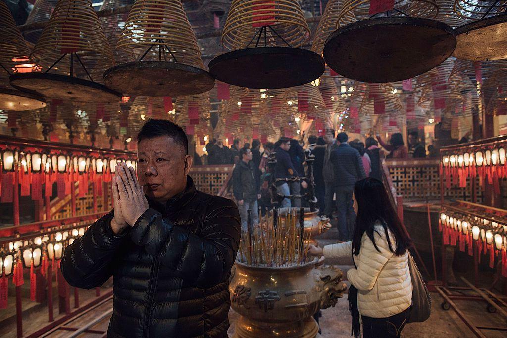 Supplicant at Man Mo Temple, Hong Kong