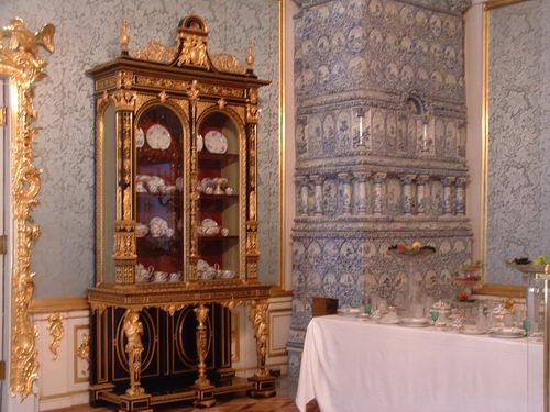 Breakfront Cabinet and Ceramic Stove in the Peterhof Grand Palace near St. Petersburg, Russia