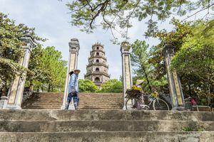 Locals in front of Thien Mu Pagoda, Hue, Vietnam
