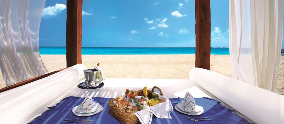 Covered beach cabana with picnic for two