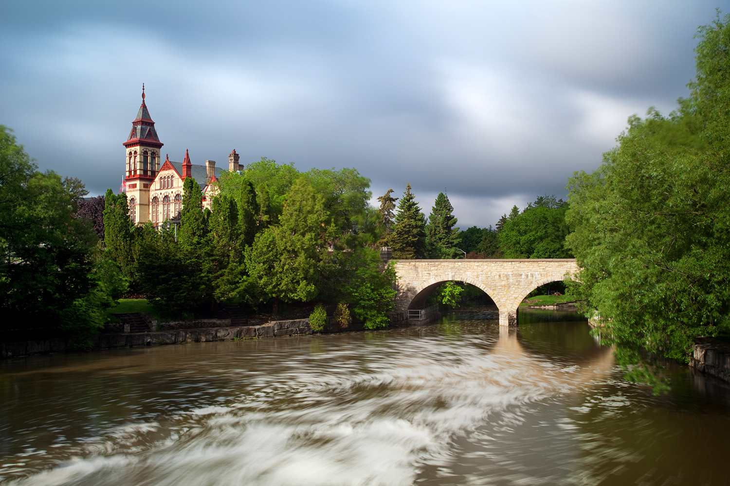 Stratford courthouse in Stratford Ontario behind the Avon river.