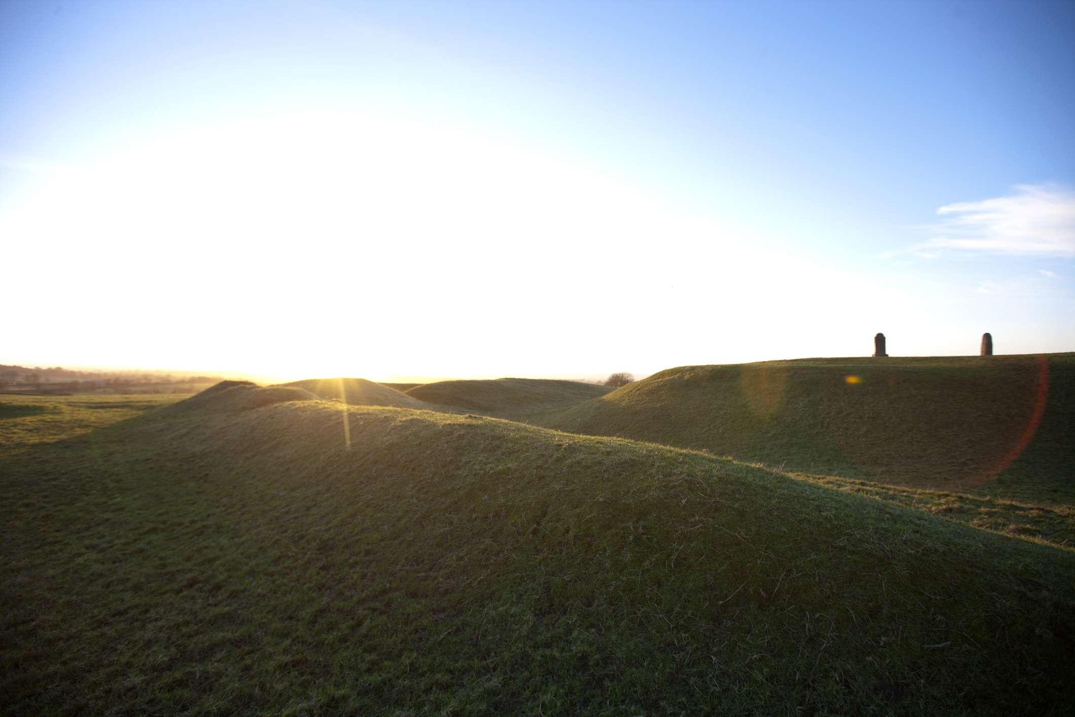 green hill of tara with sun