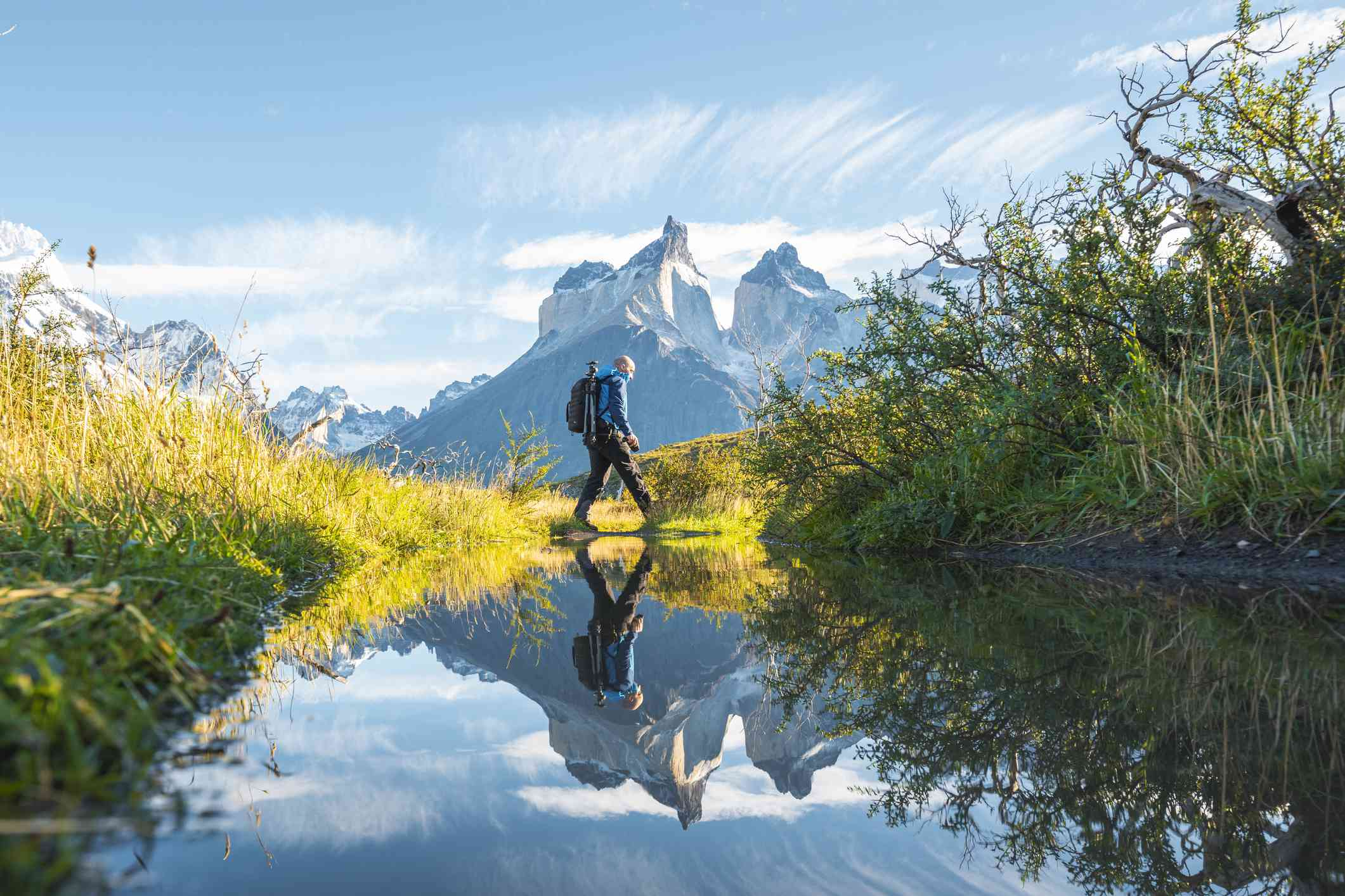 One man crossing a pond in Torres del Paine National Park, Chile