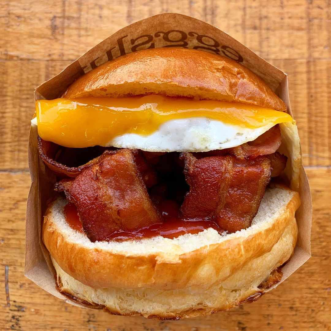 bacon egg and cheese sandwich in a paper container