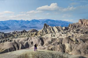 Two people Looking into Golden Canyon from Zabriskie Point, one of the most popular tourist attractions in Death Valley